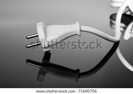 White europe standard power plug over black background with copy-space - stock photo