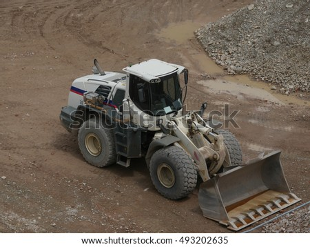 White excavator at building site