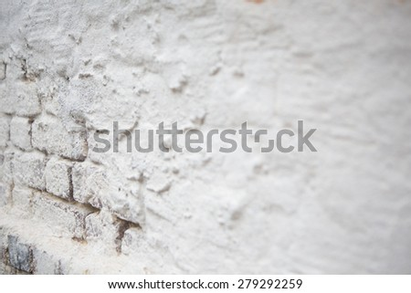 White exposed brick and stucco wall background - stock photo
