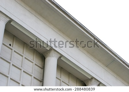 White exterior building wall with checkered pattern and white sky - stock photo