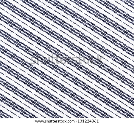 White fabric texture with diagonal stripes. Clothes background. Close up - stock photo