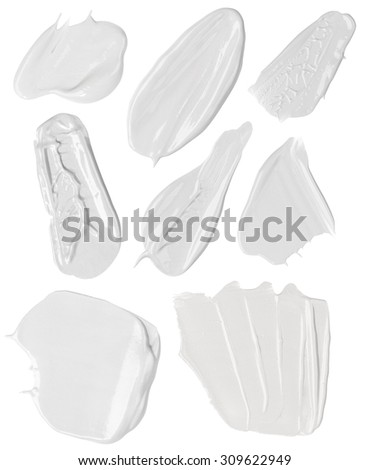 White face cream splodges isolated on white
