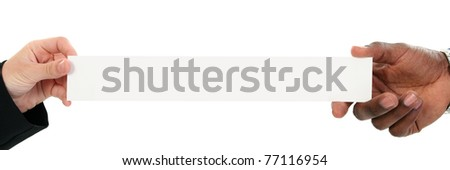 White female and black male hands holding banner with copy space over white. - stock photo
