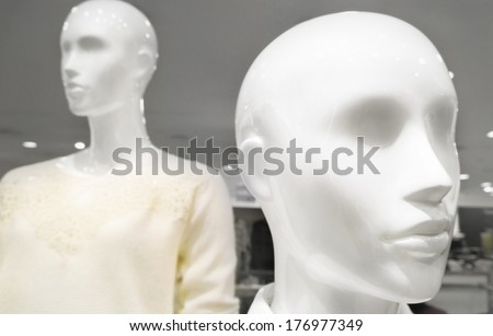 White female dummy inside a casual clothing store - stock photo