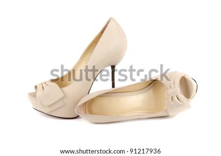 white female shoes on a white background - stock photo