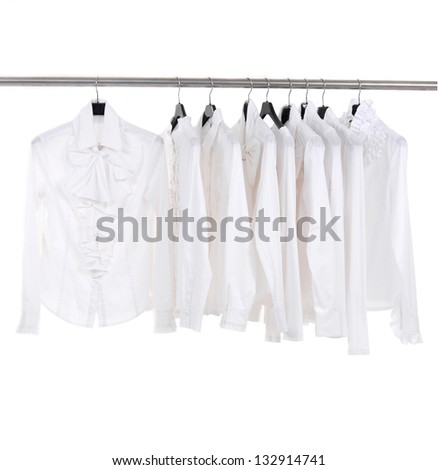 White female white jacket on hangers at the show - stock photo
