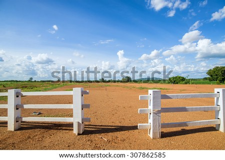 white fence and blue sky - stock photo