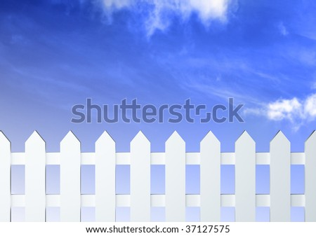 White fence in front of blue sky with clouds