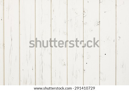 white fence made out of vertical wooden planks - stock photo