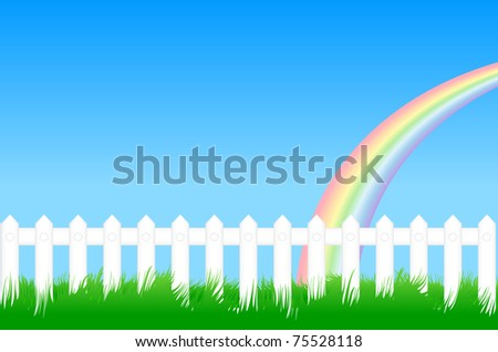 White fence with green grass and a rainbow against the blue sky - stock photo