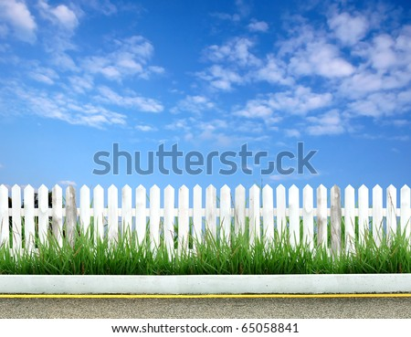 white fence with road and blue sky - stock photo
