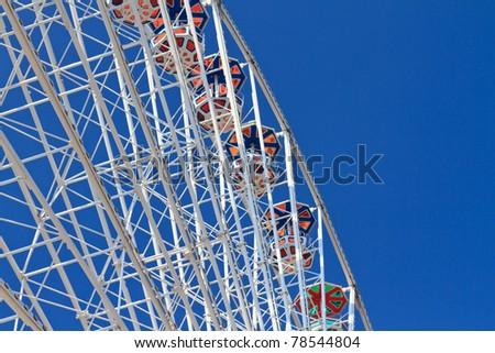 White Ferries Wheel against blue sky - stock photo