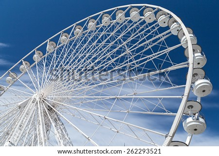 white ferris wheel on blue sky - stock photo
