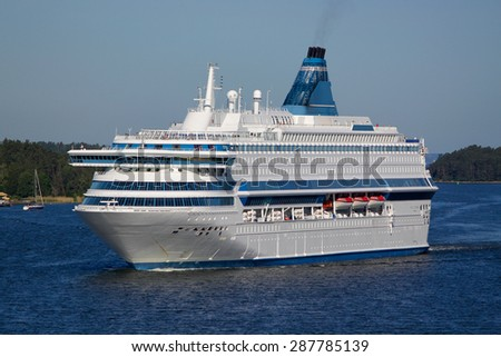 White ferry sails on the bay - stock photo
