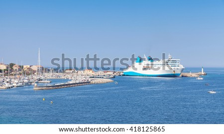 White ferry ship moored in port of Propriano, South region of Corsica island, France