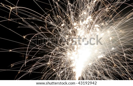 White fireworks display on black sky background - stock photo