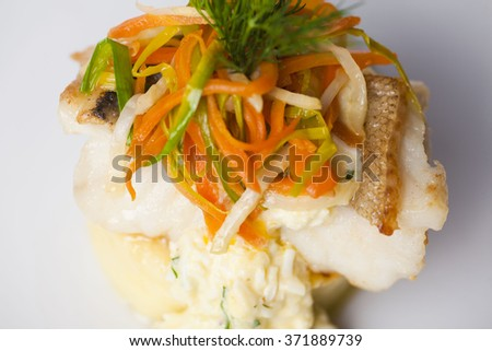 white fish with mashed potatoes and gravy, vegetables, onion dill carrot on a plate for restaurant menu isolated on a white background top - stock photo