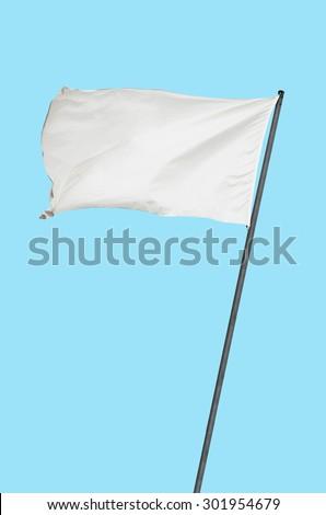 White flag over a plain blue background - stock photo
