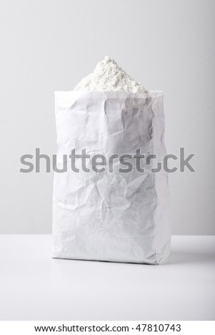 white flour in paper pack