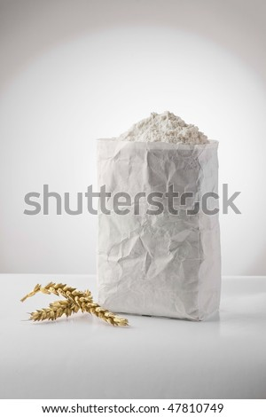 white flour in paper pack with wheat