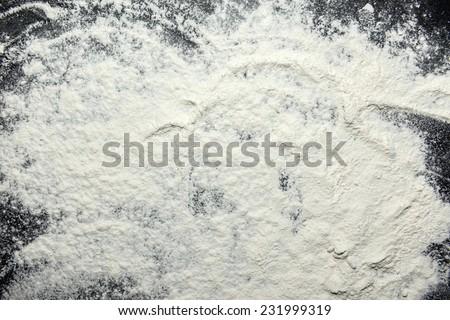 White flour on black backgorund texture photo - stock photo