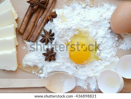 White flour with eggs, butter, cinnamon sticks, spicy anise stars and ...