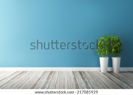 white flower plot and blue wall interior - stock photo