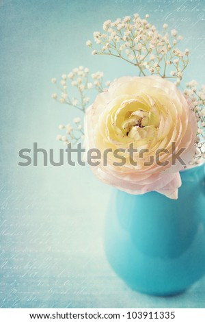 White flowers in a vase on blue background - stock photo