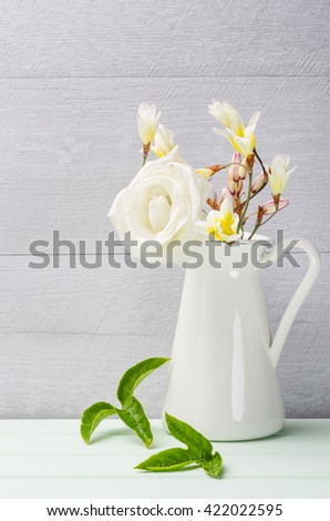 White flowers in jug. Roses in jug. Postcard background. Wedding card background. Wedding invitation on shabby chic background with copy space. - stock photo