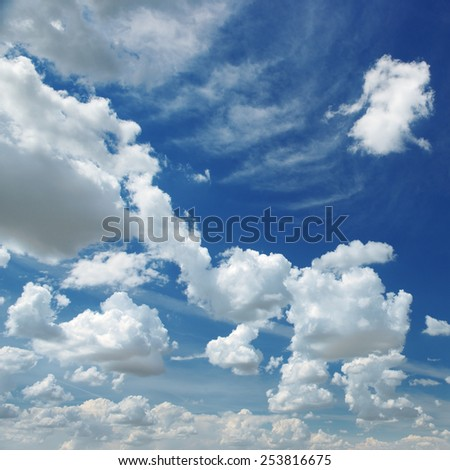 white fluffy clouds on sky - stock photo