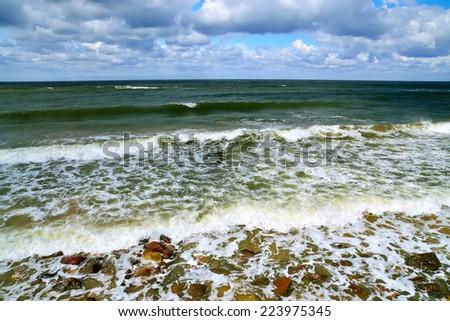 White foam of the sea surf - stock photo