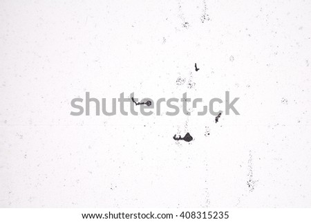 White foam with black paint traces, abstract background - stock photo