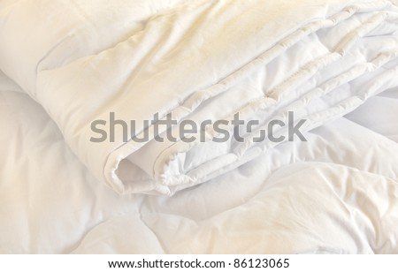 white folded cotton duvet background - stock photo