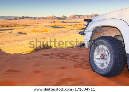 white for by four car on a sandy trail in the Kalahari desert, Namibia, Africa - stock photo