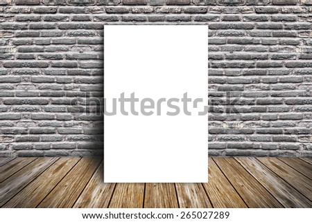 white frame on a brick wall and wooden floor - stock photo