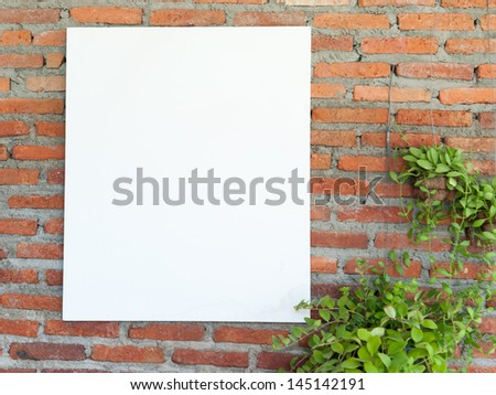 White frame on brick wall - stock photo