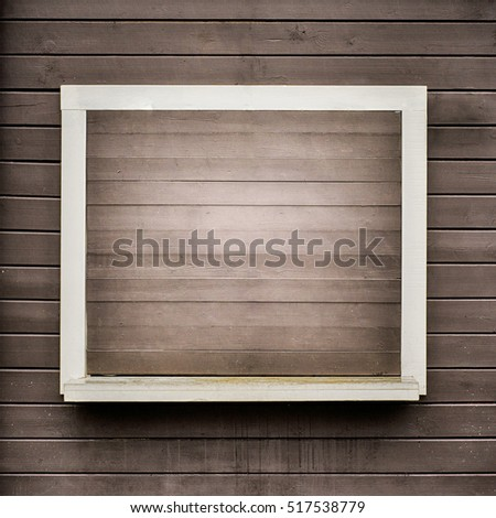 White frame on the grunge wooden plank wall