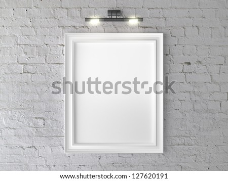 white frame on wall with wall lamp - stock photo