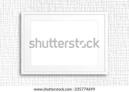 White frame on white textured wall. Interior design wallpaper,  background.  - stock photo