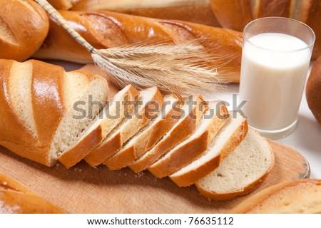 White freash bread with glass of fresh milk - stock photo