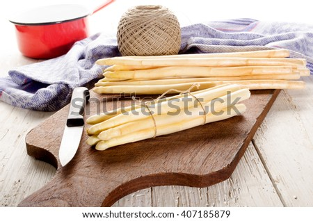 white fresh asparagus is prepared for cooking - stock photo