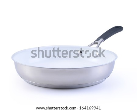 white  frying pan with a ceramic covering isolated on a white background.  - stock photo