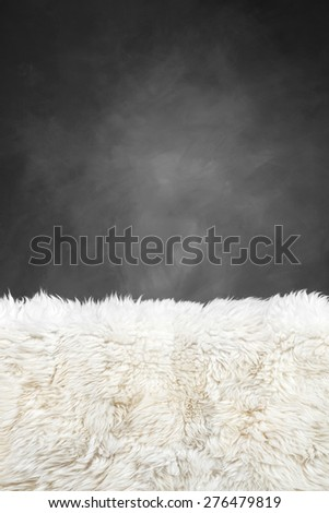 white fur carpet and dark grey painted wall , use for background - stock photo