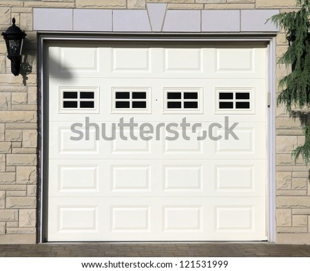 White garage door of a detached house - stock photo