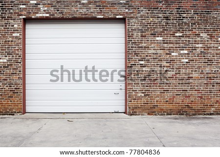 white garage door on brick wall