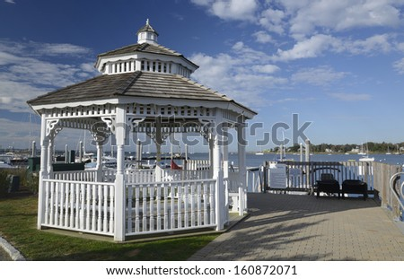 white gazebo with a shingle roof by a marina in Stonington Connecticut - stock photo
