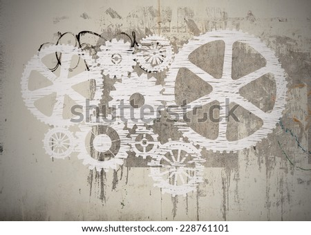White gears on gray wall - stock photo