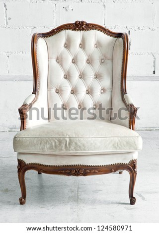 White genuine leather classical style sofa in vintage room - stock photo