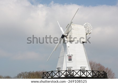 White gibbet windmill by the river Tillingham in Rye, East Sussex, England, UK. Photo taken on April 07, 2015 - stock photo