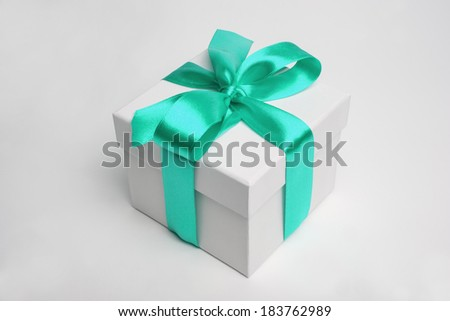 white gift box and cyan ribbon